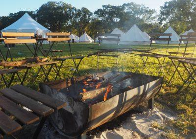 Tentz - fire pit with marquee tents behind