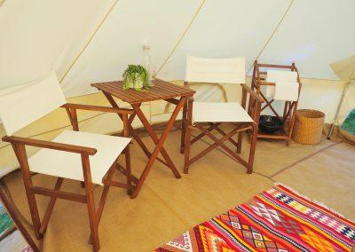 Tentz - wooden table and chairs inside the marquee tent